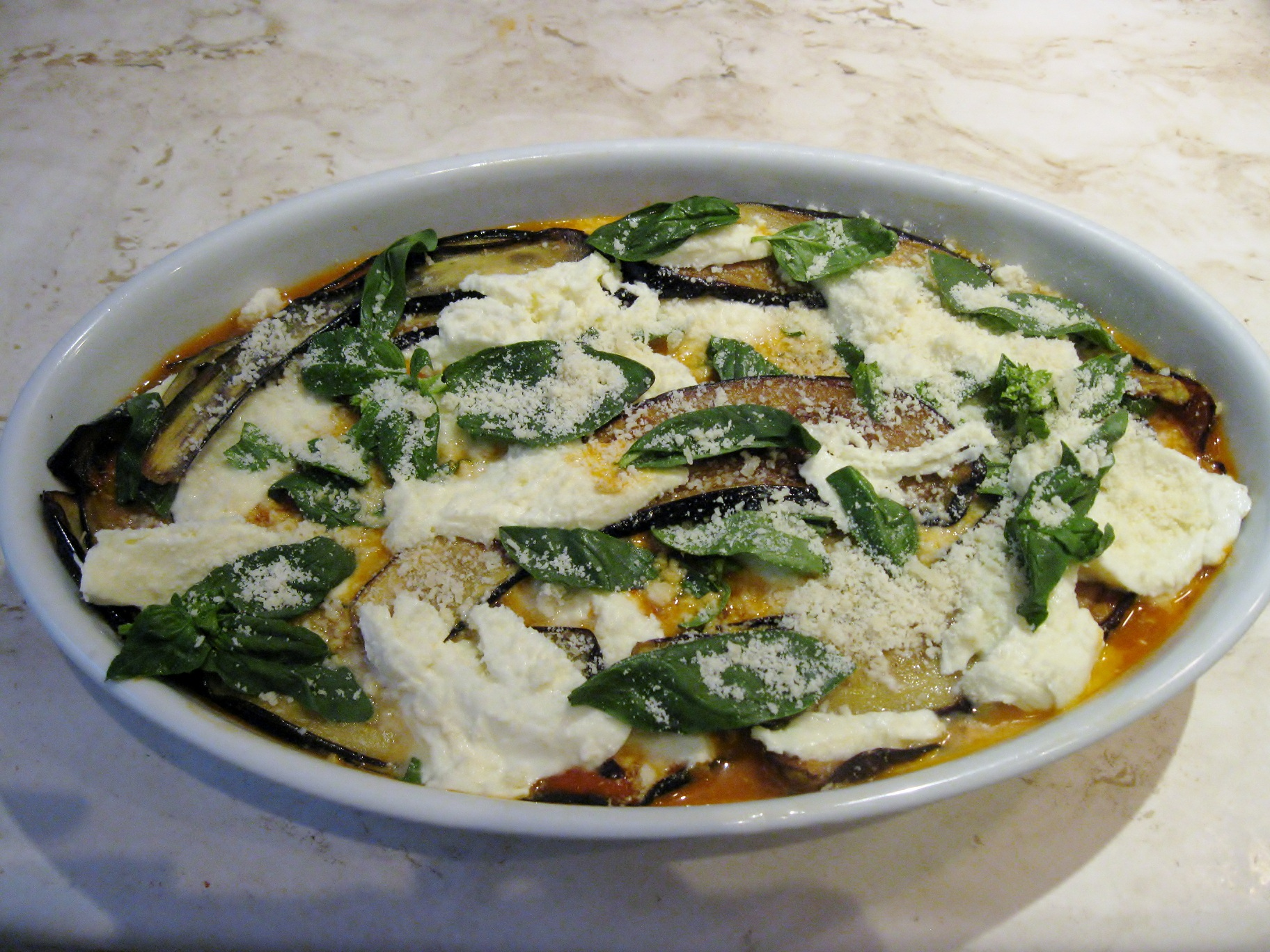 Continue layering with remaining eggplant, sauce, Fior di Latte ...